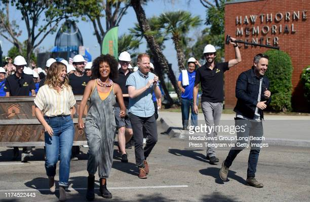 The cast and crew of Extreme Makeover Home Edition march down the street to surprise the Fifita familynin Hawthorne on Thursday September 12 2019 The...