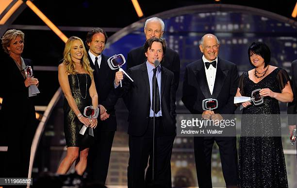 The cast and crew of Family Ties Meredith Baxter Tracy Pollan Michael Weithorn Michael J Fox Michael Gross Gary David Goldberg and Tina Yothers...