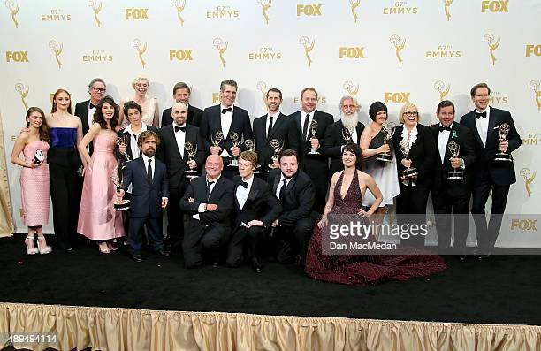 The cast and crew of 'Game of Thrones' pose with their awards for Outstanding Drama Series in the photo room at the 67th Annual Primetime Emmy Awards...