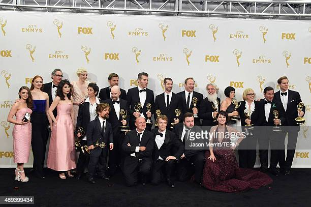 The cast and crew of 'Game of Thrones' winners of Outstanding Drama Series pose in the press room at the 67th Annual Primetime Emmy Awards at...