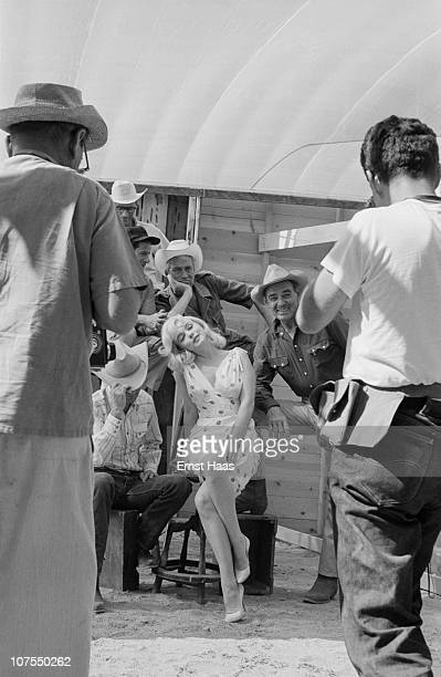 The cast and crew of John Huston's 'The Misfits' line up for a publicity shoot USA 1960 The group includes writer Arthur Miller director John Huston...