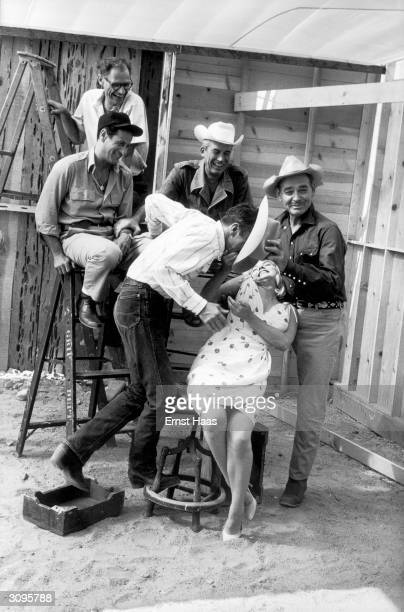 The cast and crew of John Huston's 'The Misfits' line up for a publicity shoot The group includes writer Arthur Miller actor Eli Wallach director...