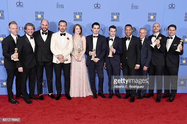 The cast and crew of 'La La Land' winners of Best Motion Picture Musical or Comedy pose in the press room during the 74th Annual Golden Globe Awards...