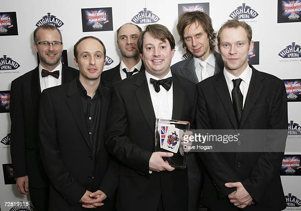 The cast and crew of Peep Show including actors Robert Webb Matt King and David Mitchell pose in the awards room with the award for Best TV Comedy of...