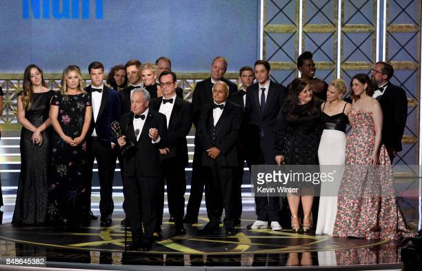 The cast and crew of Saturday Night Live accepts the Outstanding Variety Sketch Series award onstage during the 69th Annual Primetime Emmy Awards at...