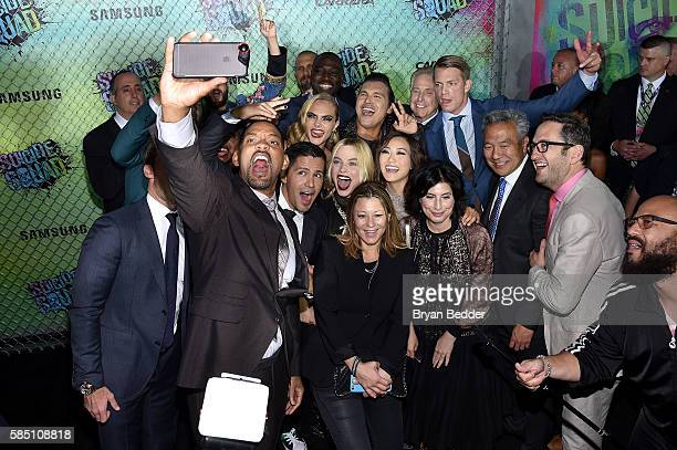 The cast and crew of Suicide Squade take a selfie during the Suicide Squad premiere sponsored by Carrera at Beacon Theatre on August 1, 2016 in New...