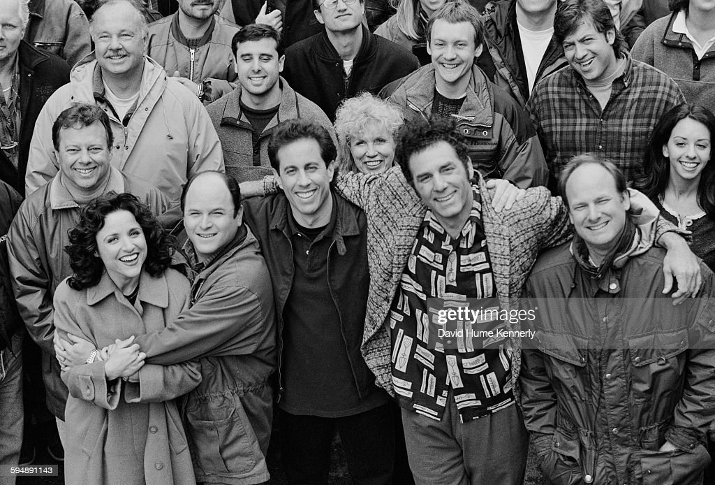 The cast and crew of the hit television show 'Seinfeld' pose on set during the last days of filming the final episode, April 3, 1998 in Studio City, California.. From left to right in the front row are actors Julia Louis-Dreyfus (Elaine), Jason Alexander (George), Jerry Seinfeld (Jerry), Michael Richards (Kramer), and director Andy Ackerman.
