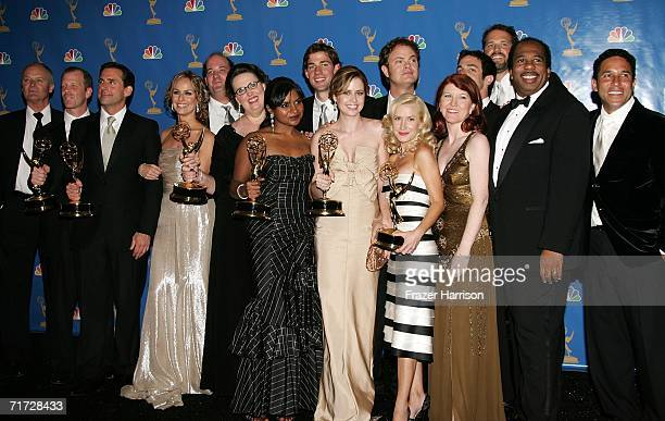 """The cast and crew of """"The Office"""" pose in the press room with their award for Outstanding Comedy Series at the 58th Annual Primetime Emmy Awards at..."""