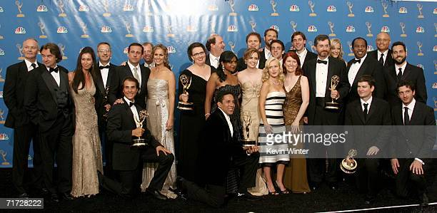 """The cast and crew of """"The Office"""" poses in the press room after winning """"Outstanding Comedy Series"""" at the 58th Annual Primetime Emmy Awards at the..."""