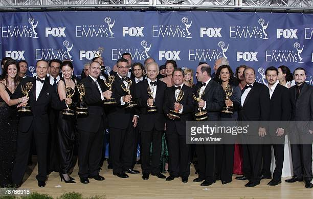 The cast and crew of 'The Sopranos' poses in the pressroom after their win for 'Outstanding Drama Series' during the 59th Annual Primetime Emmy...