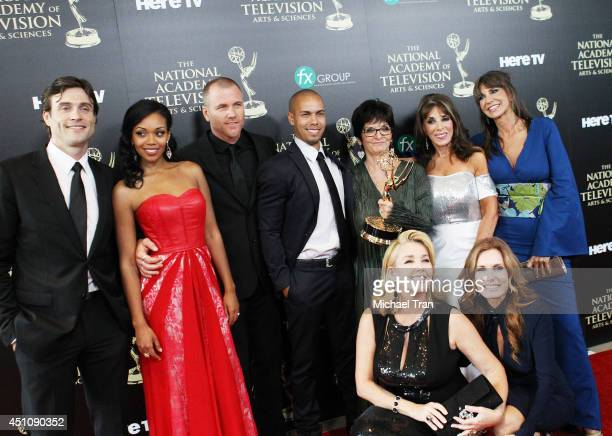 The cast and crew of The Young and the Restless pose in the press room with the award for Outstanding Drama Series the 41st Annual Daytime Emmy...