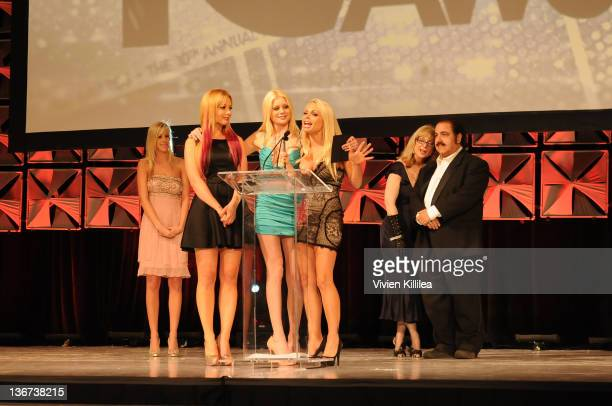 The cast and crew of 'Top Guns' accept their award for Parody Release of the Year Drama at the 10th Annual XBIZ Awards at The Barker Hanger on...
