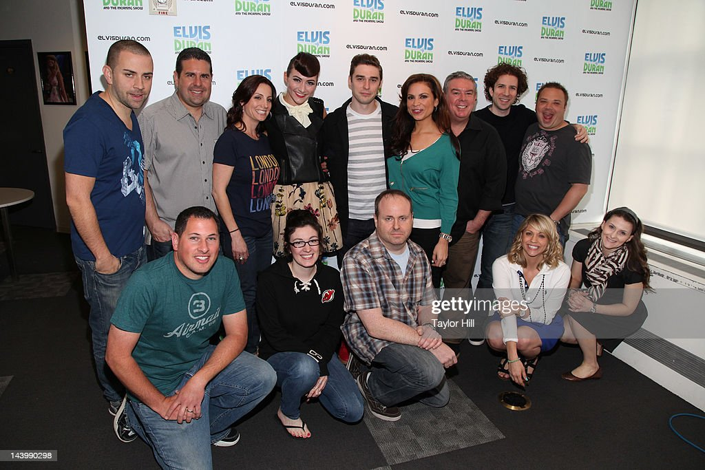 The cast and crew of Z100 pose with Karmin at Z100 Studio on
