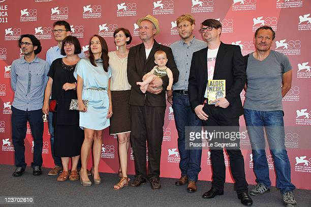 The cast and crew with baby pose at the Alois Nebe photocall during the 68th Venice Film Festival at the Palazzo del Cinema on September 4 2011 in...