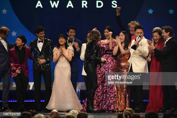 The cast and producers of Crazy Rich Asians accept the award for Best Comedy Movie onstage during the 24th annual Critics' Choice Awards at Barker...