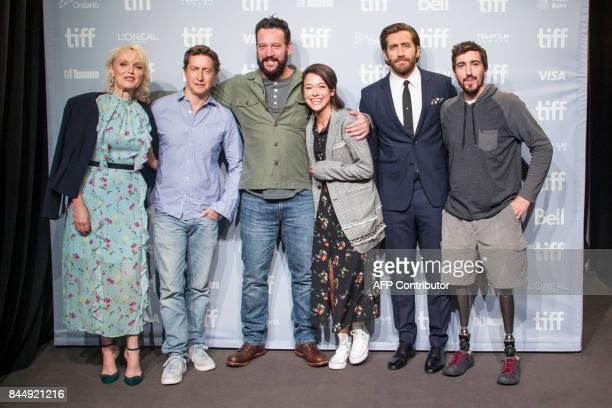 """The cast andrew of """"Stronger"""" Miranda Richardson, David Gordon Green, John Pollono, Tatiana Maslany, Jake Gyllenhaal and Jeff Bauman pose for a photo..."""