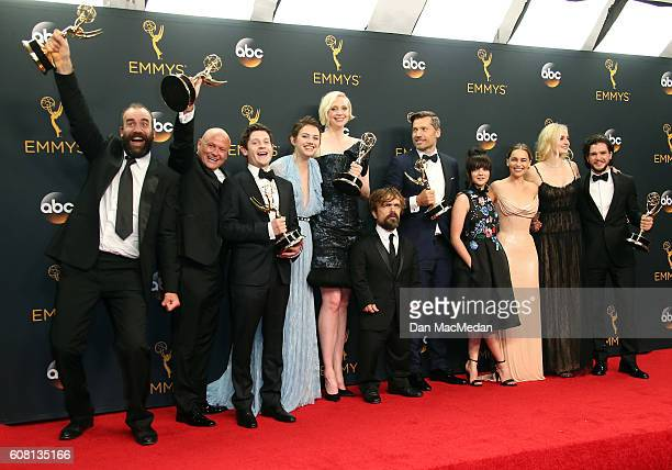 The cast crew of 'Game of Thrones' winners of Outstanding Drama Series pose in the press room at the 68th Annual Primetime Emmy Awards at Microsoft...