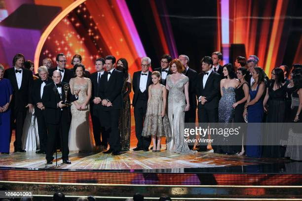 The cast crew of Mad Men accept the Outstanding Drama Series award onstage during the 63rd Annual Primetime Emmy Awards held at Nokia Theatre LA LIVE...