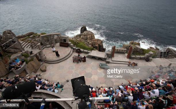 The cast from the Ilkley Playhouse perform Wuthering Heights on stage at the Minack Theatre on August 2 2013 in Porthcurno near Penzance Cornwall The...