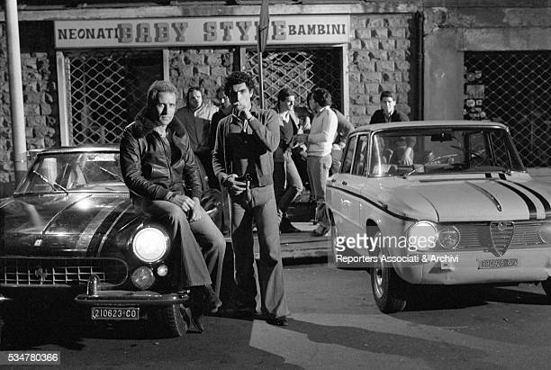 The cast in Highway Racer preparing a scene with cars Italy 1977