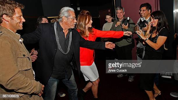 The cast including actor Edward James Olmos second from left and actor Mary McDonnell third from left pull Kerry Norton second from right and wife of...