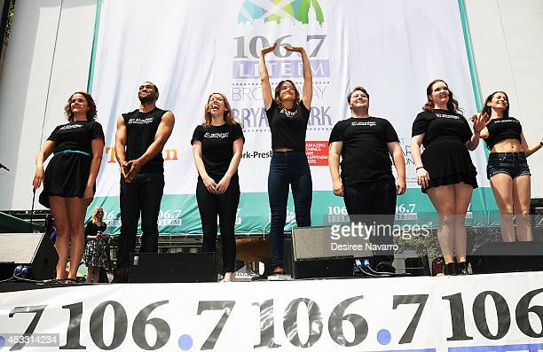 The cast members from '50 Shades' The Musical perform during 1067 LITE FM's Broadway in Bryant Park 2014 at Bryant Park on August 7 2014 in New York...
