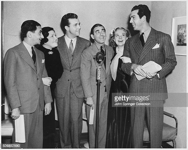 The cast members of the movie Hollywood Hotel from left to right Irving Berlin Louella Parsons Dick Powell Eddie Cantor Alice Faye and Fred MacMurray...