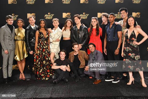 The cast of '13 Reasons Why' pose in the press room at the 2017 MTV Movie and TV Awards at The Shrine Auditorium on May 7 2017 in Los Angeles...