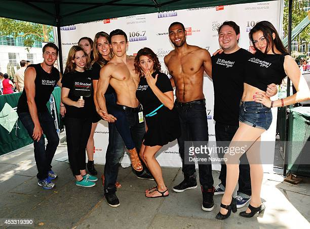 The cast of '50 Shades ' The Musical attend 1067 LITE FM's Broadway in Bryant Park 2014 at Bryant Park on August 7 2014 in New York City