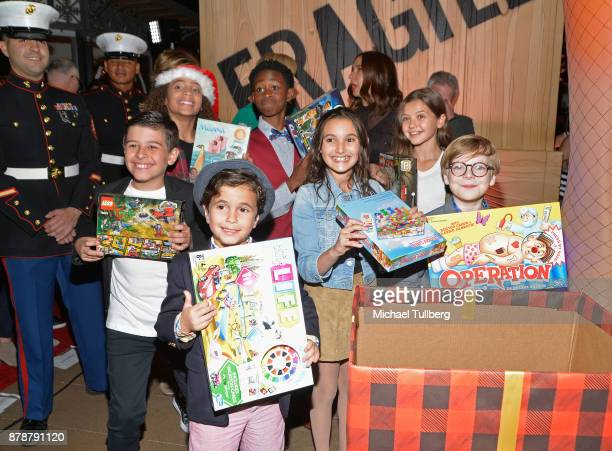The cast of A Christmas Story Live donate presents for Toys For Tots at FOX's A Christmas Story Live Lighting Event featuring the leg lamp at The...