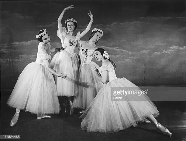 The cast of a Festival Ballet production of Jules Perrot's ballet 'Pas De Quatre', at a photo-call, London, 1950. The dancers are Nathalie Krassovska...