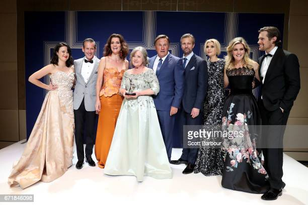 The cast of A Place to Call Home poses with the Logie Award for Most Outstanding Drama Series during the 59th Annual Logie Awards at Crown Palladium...