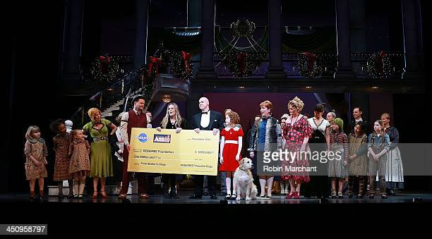 The cast of 'Annie' attends the 'Annie The Musical' On Broadway's See the Show Help a Dog Initiative Check Presentation at Palace Theatre on November...