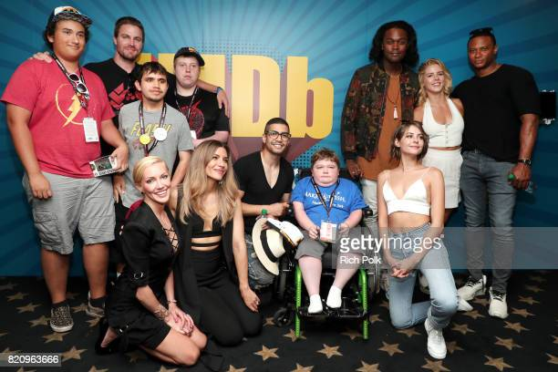 The cast of Arrow with MakeAWish kids on the #IMDboat at San Diego ComicCon 2017 at The IMDb Yacht on July 22 2017 in San Diego California