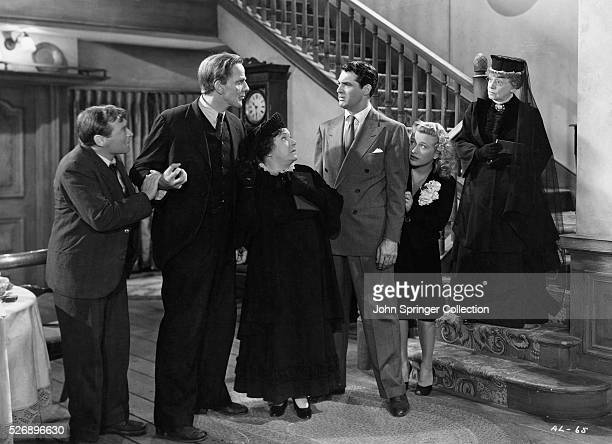 The cast of Arsenic and Old Lace acting in an ensemble scene The film stars Peter Lorre Raymond Massey Josephine Hull Cary Grant Priscilla Lane and...