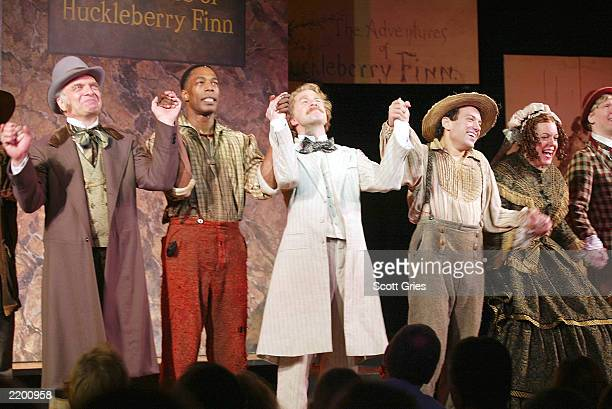 The cast of Big River The Adventures Of Huckleberry Finn during curtain call opening night at the American Airlines Theatre July 24 2003 in New York...