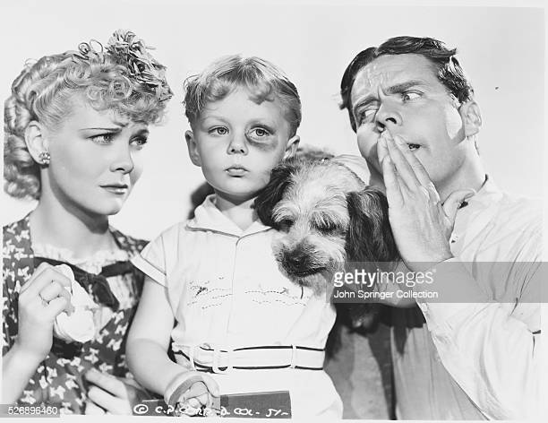 The cast of Blondie Brings Up Baby from left Penny Singleton as Blondie Bumstead Larry Simms as Alexander Bumstead Spooks the family pet and Arthur...
