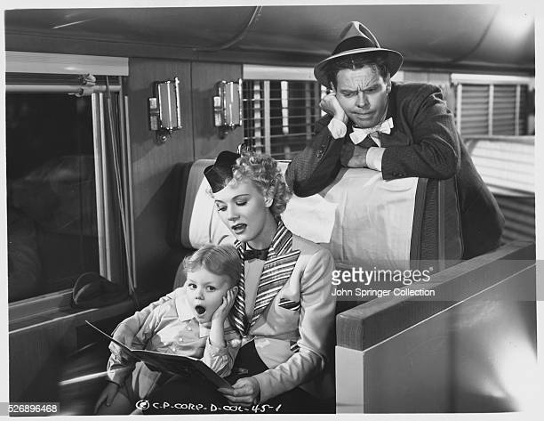 The cast of Blondie Takes a Vacation from left Larry Simms as Alexander Bumstead Penny Singleton as Blondie Bumstead and Arthur Lake as Dagwood...