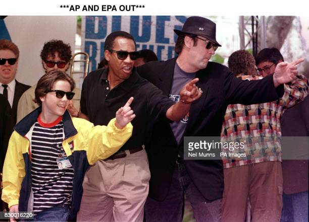 The cast of Blues Brothers 2000 J Evan Bonifant Joe Morton and Dan Ackroyd at a photocall at Planet Hollywood in Cannes France during the 51st Cannes...