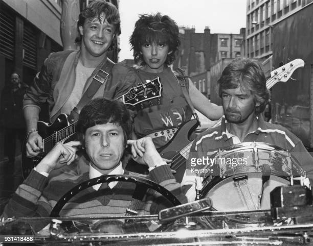 The cast of British children's television programme 'MultiColoured Swap Shop' pose in London to publicise the start of a new series and the release...