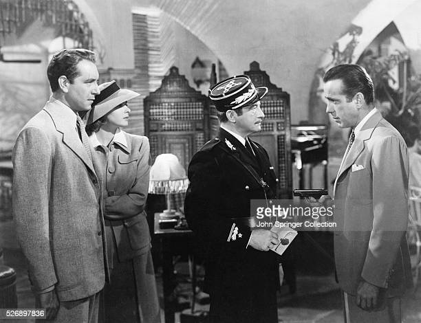 The cast of Casablanca from left to right Paul Henreid as Victor Laszlo Ingrid Bergman as Ilsa Lund Laszlo Claude Rains as Captain Louis Renault and...