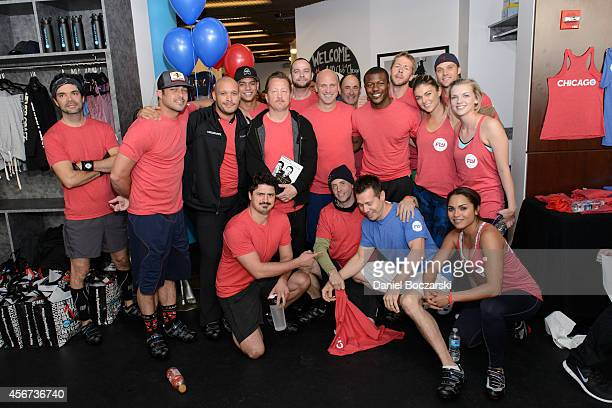 The cast of Chicago Fire participates in a Flywheel Sports ride to benefit the 100 Club of Chicago at Flywheel Sports on October 5 2014 in Chicago...