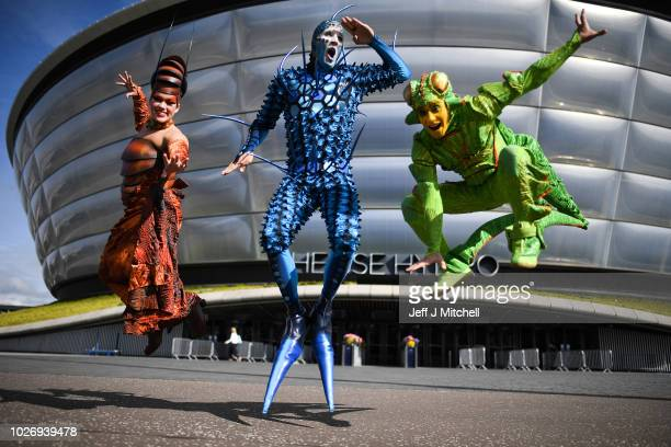 The cast of Cirque du Soleil's OVO Julia Tazie from Brazil Jan Duther from Switzerland and Nathan RiveraDrydak from Canada pose during a photo call...