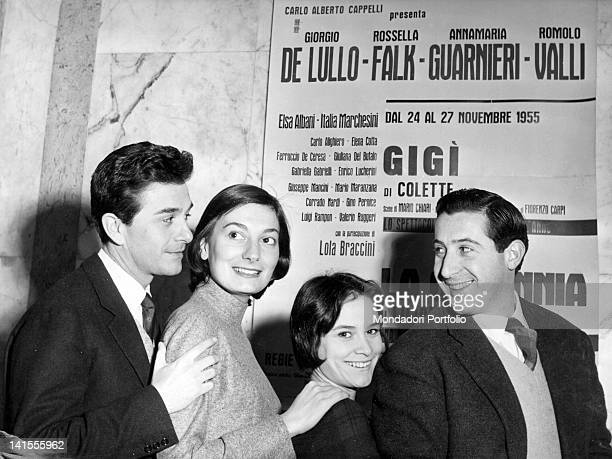 The cast of Colette's comedy 'Gigi' directed by Giorgio De Lullo posing in front of a poster. Italy, 1951