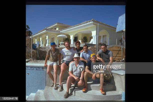 The cast of comedy drama series Auf Wiedersehen, Pet photographed on location in Spain, including Kevin Whately, Pat Roach, Gary Holton, Tim Healy,...
