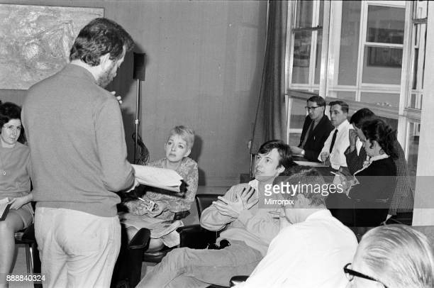 The cast of 'Coronation Street' on set. Tim Jones, director, speaks to Mitzi Rogers and Philip Lowrie, 16th April 1968.