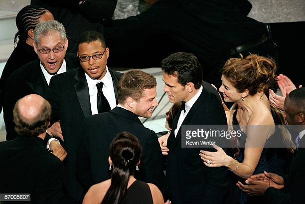 BROADCAST*** The cast of Crash congratulate each other on the Best Picture win during the 78th Annual Academy Awards at the Kodak Theatre on March 5...