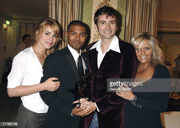 The Cast of Doctor Who including Billie Piper Noel Clarke David Tennant and Camille Coduri pose with the award for Best Loved Drama Series at the TV...