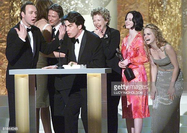 The cast of film 'American Beauty' Kevin Spacey Allison Janney Chris Cooper Peter Gallagher Annette Bening Thora Birch Mena Suvari celebrate on stage...