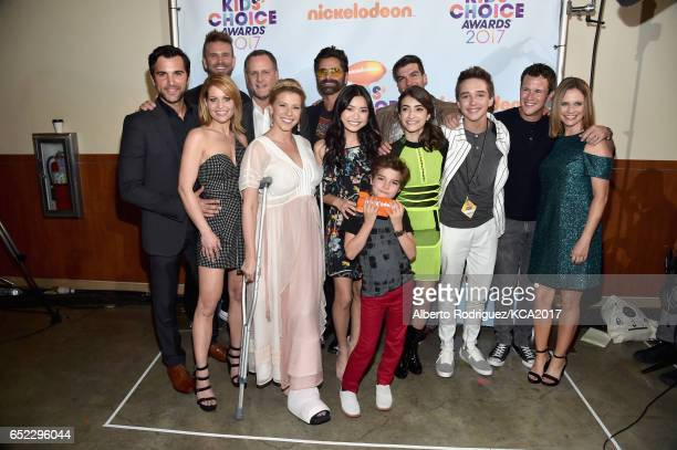 The cast of Fuller House backstage after winning the award for Favorite Family TV Show at Nickelodeon's 2017 Kids' Choice Awards at USC Galen Center...